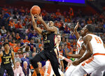 Florida State's Trent Forrest (3) drives to the basket while defended by Clemson's Trey Jemison, right, and Aamir Simms, center, during the first half of an NCAA college basketball game Tuesday, Feb. 19, 2019, in Clemson, S.C. (AP Photo/Richard Shiro)