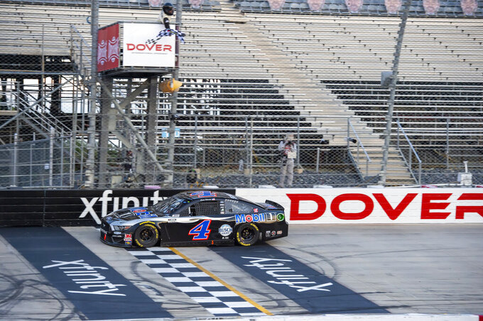Kevin Harvick (4) wins a NASCAR Cup Series auto race at Dover International Speedway, Sunday, Aug. 23, 2020, in Dover, Del. (AP Photo/Jason Minto)