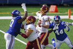 Washington Football Team offensive guard Wes Schweitzer (71) blocks New York Giants' Dexter Lawrence (97) as quarterback Kyle Allen (8) throws a pass during the first half of an NFL football game Sunday, Oct. 18, 2020, in East Rutherford, N.J. (AP Photo/John Minchillo)