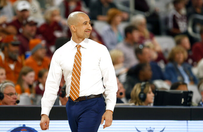 Texas head coach Shaka Smart looks on as Texas plays Texas A&M during the first half of an NCAA college basketball game, Sunday, Dec. 8, 2019, in Fort Worth, Texas. Texas won 60-50. (AP Photo/Ron Jenkins)