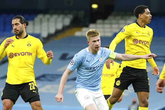 Manchester City's Kevin De Bruyne, center, celebrates after scoring his side's first goal during the Champions League, first leg, quarterfinal soccer match between Manchester City and Borussia Dortmund at the Etihad stadium in Manchester, Tuesday, April 6, 2021. (AP Photo/Dave Thompson)