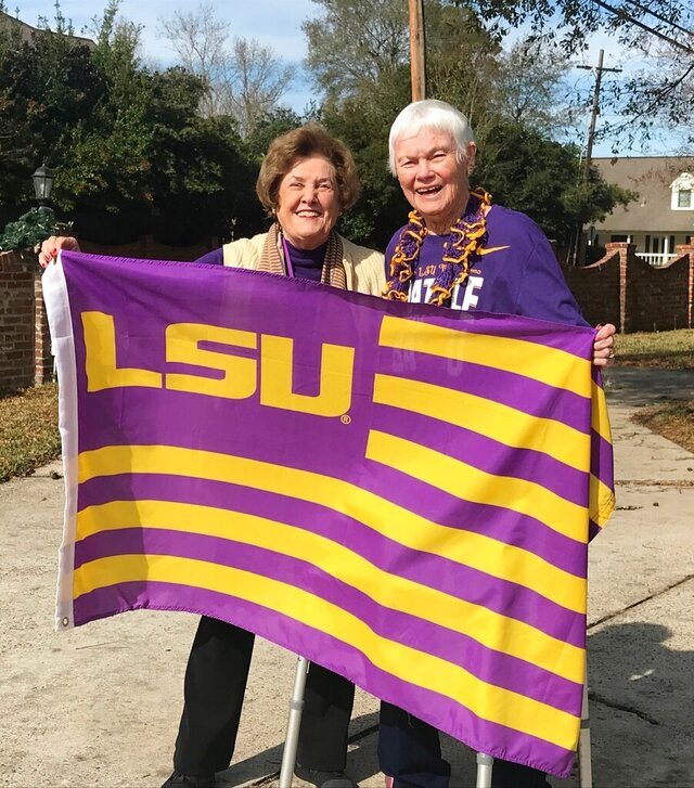 In this recent photo, lifelong friends Cissie McLeod and Angel Wright, who were roommates at LSU when their alma mater won its first national title in 1958, pose in New Orleans. The pair were in New Orleans as they watched their beloved Tigers capture another title. (Kathleen Hilliard/American Press via AP)