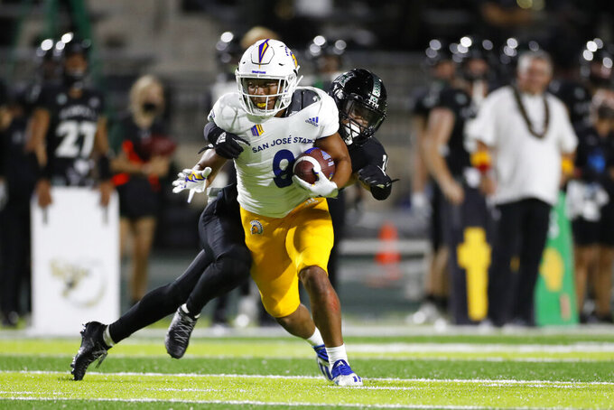 San Jose State wide receiver Isaiah Hamilton (9) tries to get past Hawaii defensive back Kai Kaneshiro (24) during the first half of an NCAA college football game, Saturday, Sept. 18, 2021, in Honolulu. (AP Photo/Marco Garcia)