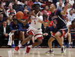 Stanford's Daejon Davis, left, looks to pass the ball away from Arizona's Jemarl Baker Jr. during the first half of an NCAA college basketball game Saturday, Feb. 15, 2020, in Stanford, Calif. (AP Photo/Ben Margot)