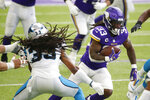 Minnesota Vikings running back Dalvin Cook (33) runs from Carolina Panthers safety Tre Boston, left, during the first half of an NFL football game, Sunday, Nov. 29, 2020, in Minneapolis. (AP Photo/Bruce Kluckhohn)