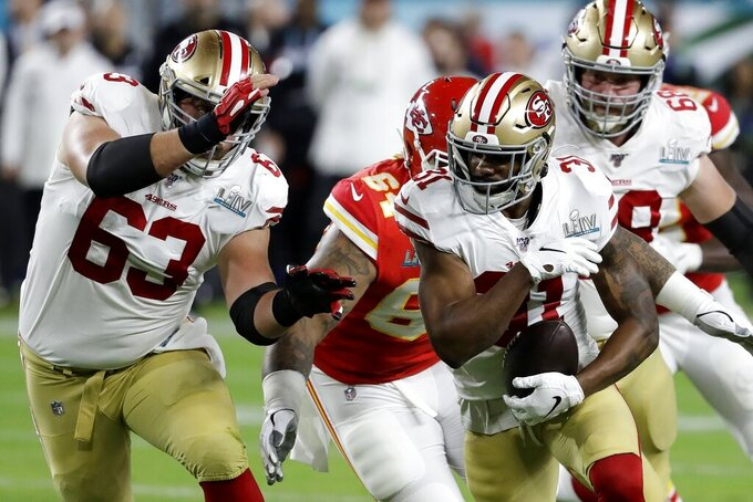 San Francisco 49ers' Raheem Mostert (31) runs against the Kansas City Chiefs during the first half of the NFL Super Bowl 54 football game Sunday, Feb. 2, 2020, in Miami Gardens, Fla. (AP Photo/Seth Wenig)