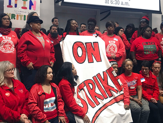 Members of the Chicago Teachers Union House of Delegates hold a press conference after members turned down the district's latest offer, Wednesday, Oct. 16, 2019 in Chicago. Chicago parents and community groups are scrambling to prepare for a massive teachers' strike set to begin Thursday, prompting the city to preemptively cancel classes in the nation's third-largest school district. (Matthew Hendrickson/Chicago Sun-Times via AP)