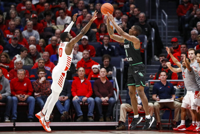 North Texas' Umoja Gibson (1) shoots over Dayton's Jalen Crutcher (10) during the first half of an NCAA college basketball game, Tuesday, Dec. 17, 2019, in Dayton, Ohio. (AP Photo/John Minchillo)