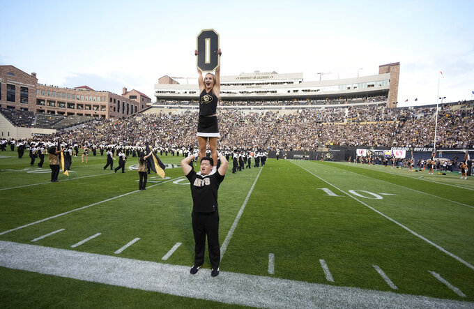 Cheerleaders perform before Colorado hosts Northern Colorado in an NCAA college football game Friday, Sept. 3, 2021, in Boulder, Colo. (AP Photo/David Zalubowski)