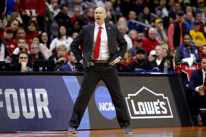 Louisville coach Chris Mack calls instructions during the second half of a first round men's college basketball game against Minnesota in the NCAA Tournament, in Des Moines, Iowa, Thursday, March 21, 2019. (AP Photo/Nati Harnik)