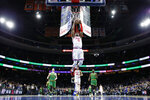 Philadelphia 76ers' Josh Richardson (0) goes up to dunk during the second half of an NBA basketball game against the Boston Celtics, Thursday, Jan. 9, 2020, in Philadelphia. (AP Photo/Matt Slocum)