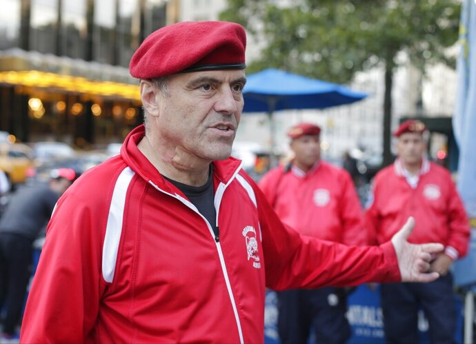 FILE - In this Aug. 12, 2015, file photo, Guardian Angels founder Curtis Sliwa responds to questions during a news interview in New York. Sliwa donned a wetsuit and his trademark Guardian Angels red beret and strode into the water at Coney Island Sunday, May 24, 2020, in defiance of Mayor Bill de Blasio's no-swimming order. (AP Photo/Frank Franklin II, File)