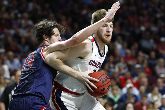 Gonzaga's Drew Timme (2) drives into Saint Mary's Kyle Bowen (14) in the first half of an NCAA college basketball game in the final of the West Coast Conference men's tournament Tuesday, March 10, 2020, in Las Vegas. (AP Photo/John Locher)