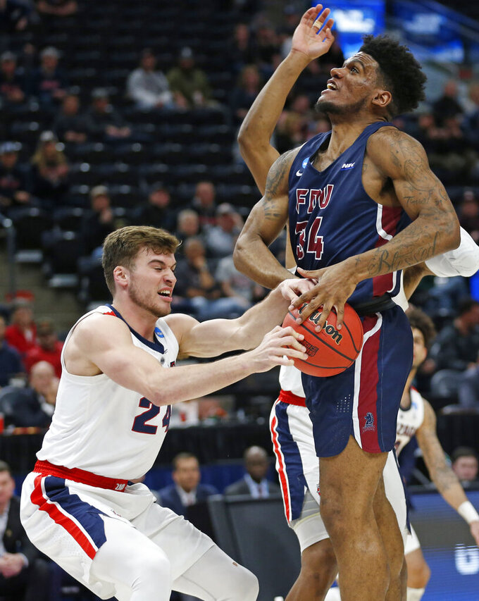 Gonzaga forward Corey Kispert (24) steals the ball from Fairleigh Dickinson forward Mike Holloway Jr. (34) during the first half of a first-round game in the NCAA men's college basketball tournament Thursday, March 21, 2019, in Salt Lake City. (AP Photo/Rick Bowmer)