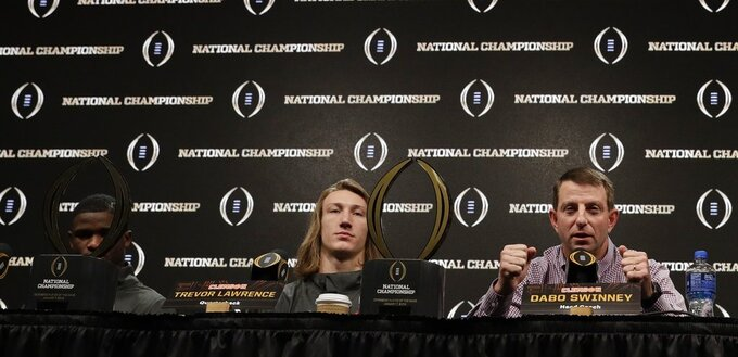 Clemson head coach Dabo Swinney, Trevor Lawrence and Trayvon Mullen answer questions at a news conference for the NCAA college football playoff championship game Tuesday, Jan. 8, 2019, in San Jose, Calif. (AP Photo/David J. Phillip)