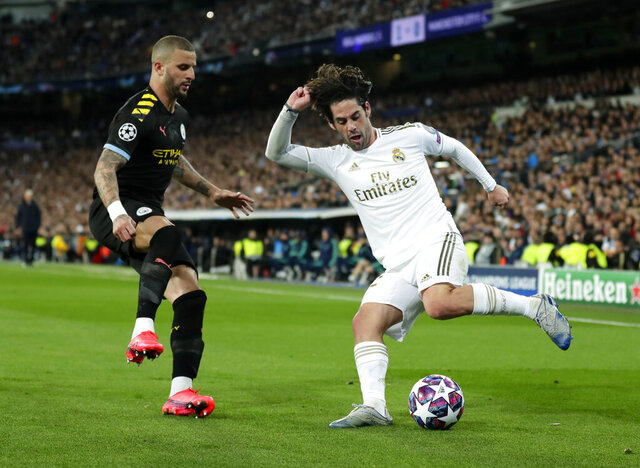 "FILE  - In this Wednesday, Feb. 26, 2020 file photo, Real Madrid's Isco, right, duels for the ball with Manchester City's Kyle Walker during the Champions League, round of 16, first leg soccer match between Real Madrid and Manchester City at the Santiago Bernabeu stadium in Madrid, Spain. Manchester City's appeal against a two-year ban from European soccer will be heard over three days in June. The Court of Arbitration for Sport says it has set aside June 8-10 for the case. It is unclear if a hearing will be held in person at the court or by video link. No timetable was set for a verdict but a ruling is needed before English teams enter next season's Champions League draw. Man City was banned by UEFA in February for ""serious breaches"" of financial monitoring rules and failing to cooperate with investigators. (AP Photo/Manu Fernandez, File)"