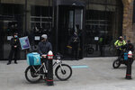 Gig economy riders for app-based meal delivery platform Deliveroo demonstrate outside the company headquarters in London, Wednesday, April 7, 2021. The strike coincides with the first day of unconditional trading for Deliveroo shares, which went public last week in a stock market offering.(AP Photo/Alastair Grant)