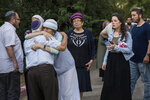 People attend the funeral of Israeli soldier Dvir Sorek, at the Israeli settlement of Ofra in the West Bank, Thursday, Aug. 8, 2019. Dvorek was found dead with stab wounds hours earlier Thursday. (AP Photo/Tsafrir Abayov)