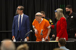 Joseph James DeAngelo, center, charged with being the Golden State Killer, his helped up by his attorney, Diane Howard, as Sacramento Superior Court Judge Michael Bowman enters the courtroom in Sacramento, Calif. Monday June 29, 2020. DeAngelo, 74, is expected to plead guilty 40 years after a sadistic series of assaults and slayings in California. Due to the large numbers of people attending, the hearing was held at a ballroom at California State University, Sacramento to allow for social distancing. (AP Photo/Rich Pedroncelli)