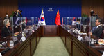 Chinese Foreign Minister Wang Yi, right, talks with South Korean Foreign Minister Kang Kyung-wha during their meeting at the foreign ministry in Seoul, South Korea, Thursday, Nov. 26, 2020.  Wang arrived in Seoul on Nov. 25, for a three-day state visit.(Kim Min-hee/Pool Photo via AP)