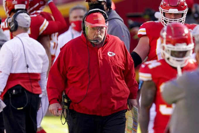 Kansas City Chiefs head coach Andy Reid, center, walks along the sideline in the first half of an NFL football game against the New York Jets on Sunday, Nov. 1, 2020, in Kansas City, Mo. (AP Photo/Charlie Riedel)