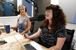 """Tess Barker, left, and Barbara Gray, co-hosts of the """"Britney's Gram"""" podcast, talk in the Earwolf podcast studio, Thursday, July 15, 2021, in Los Angeles. (AP Photo/Chris Pizzello)"""
