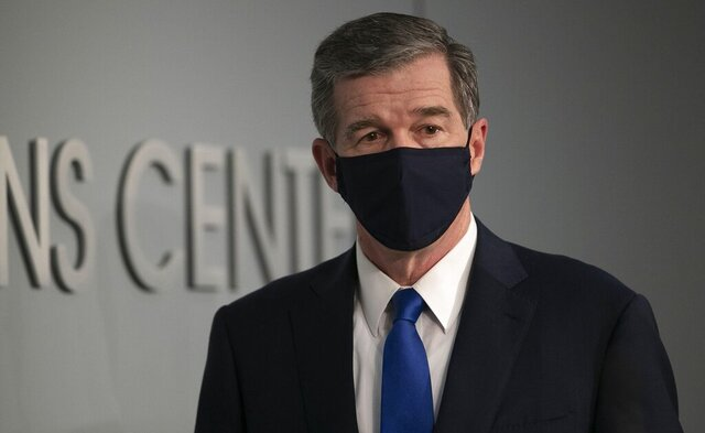 North Carolina Gov. Roy Cooper arrives for a press briefing on the COVID-19 virus at the Emergency Operations Center on Wednesday, June 24, 2020 in Raleigh, N.C. (Robert Willett/The News & Observer via AP)