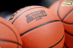 A basketball with March Madness 2019 sits in a rack before Michigan practice at the NCAA college basketball tournament in Des Moines, Iowa, Wednesday, March 20, 2019. (AP Photo/Nati Harnik)