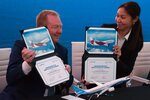 Boeing Commercial Airplanes president and CEO Stanley A. Deal, left, and Air Astana chief planning officer Alma Aliguzhinova pose at a news conference at the Dubai Airshow in Dubai, United Arab Emirates, Tuesday, Nov. 19, 2019. Kazakhstan's national carrier Air Astana announced Tuesday a letter of intent to purchase 30 of Boeing's 737-8 Max jets for its new budget airliner FlyArystan. (AP Photo/Jon Gambrell)