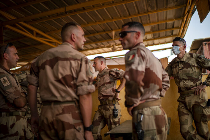French Barkhane force soldiers who wrapped up a four-month tour of duty in the Sahel leave their base in Gao, Mali Wednesday June 9, 2021.  After France suspended joint military operations with Malian forces after the junta led by Col. Assimi Goita retook control of Mali's transitional government May 24 2021, French President Emmanuel Macron announced at a press conference Thursday June 10, 2021 That operation Barkhane would end and be replaced by support for local partners and counter terrorism. (AP Photo/Jerome Delay)
