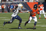 Chicago Bears running back Tarik Cohen runs from Los Angeles Chargers defensive back Rayshawn Jenkins, left, after catching a pass during the first half of an NFL football game, Sunday, Oct. 27, 2019, in Chicago. (AP Photo/Charles Rex Arbogast)