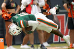 Miami wide receiver Brashard Smith scores a touchdown during the first half of an NCAA college football game against Central Connecticut State , Saturday, Sept. 25, 2021, in Miami Gardens, Fla. (AP Photo/Lynne Sladky)