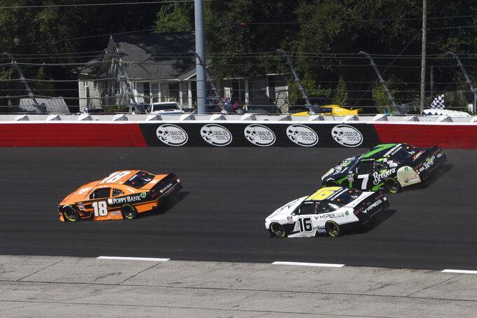 Daniel Hemric (18) is followed by AJ Allmendinger (16) and Justin Allgaier (7) during a NASCAR Xfinity Series auto race Saturday, Sept. 4, 2021, in Darlington, S.C. (AP Photo/John Amis)