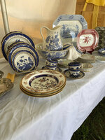 This Sept. 7, 2019 photo provided by Tracee Herbaugh shows shows a variety of china for sale at the Brimfield Flea Market in Brimfield, Mass. (Tracee Herbaugh via AP)