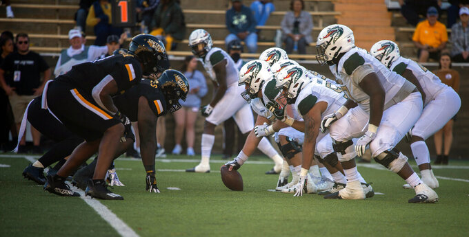 Southern Mississippi, left, and UAB face off at the line of scrimmage during the third quarter of an NCAA college football game in Hattiesburg, Miss., Saturday, Oct. 16, 2021. (Dominic Gwinn/Hattiesburg American via AP)