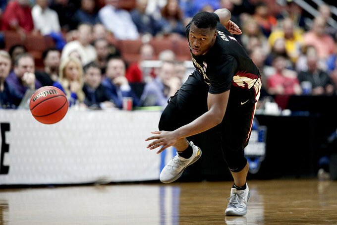 Florida State forward Raiquan Gray runs after a loose ball during the first half of the team's NCAA men's college basketball tournament West Region semifinal against Gonzaga on Thursday, March 28, 2019, in Anaheim, Calif. (AP Photo/Jae C. Hong)