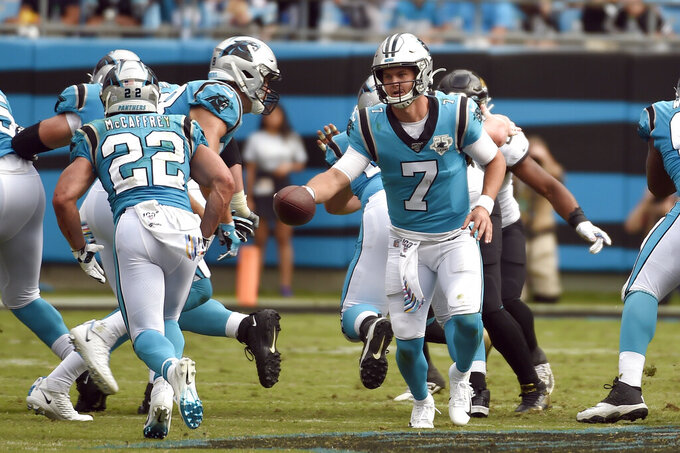 Carolina Panthers quarterback Kyle Allen (7) hands off to running back Christian McCaffrey (22) during the second half of an NFL football game in Charlotte, N.C., Sunday, Oct. 6, 2019. (AP Photo/Mike McCarn)