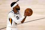 Utah Jazz's Mike Conley shoots during the third quarter against the Denver Nuggets in Game 5 of an NBA basketball first-round playoff series, Tuesday, Aug. 25, 2020, in Lake Buena Vista, Fla. (Mike Ehrmann/Pool Photo via AP)