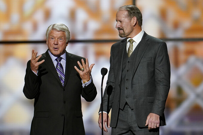 Former coaches, Jimmie Johnson, left, and Bill Cowher making introductions at the NFL Honors football award show Saturday, Feb. 1, 2020, in Miami. (AP Photo/David J. Phillip)