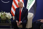 US President Donald Trump speaks during a meeting with his Iraqi counterpart Barham Salih at the World Economic Forum in Davos, Switzerland, Wednesday, Jan. 22, 2020. Trump's two-day stay in Davos is a test of his ability to balance anger over being impeached with a desire to project leadership on the world stage. (AP Photo/Evan Vucci)