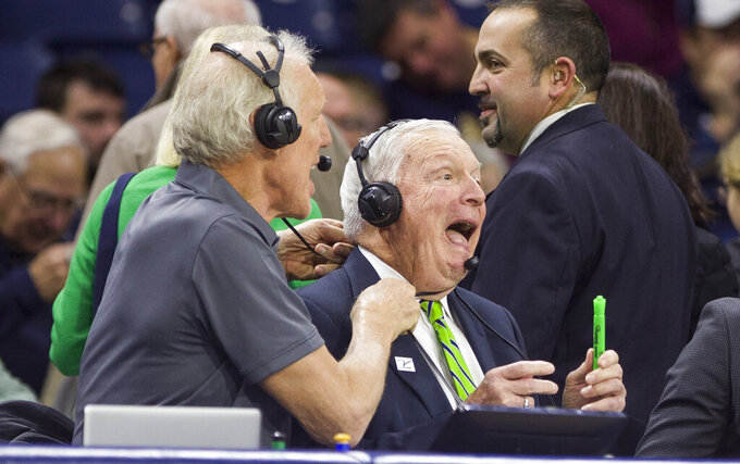 Bill Walton, left, and Digger Phelps co-host the television broadcast of an NCAA college basketball game between Notre Dame and UCLA on Saturday, Dec. 14, 2019, in South Bend, Ind. (AP Photo/Robert Franklin)