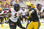 Southeast Missouri State quarterback CJ Ogbonna, left, runs past Missouri's Darius Robinson, right, during the first quarter of an NCAA college football game Saturday, Sept. 18, 2021, in Columbia, Mo. (AP Photo/L.G. Patterson)