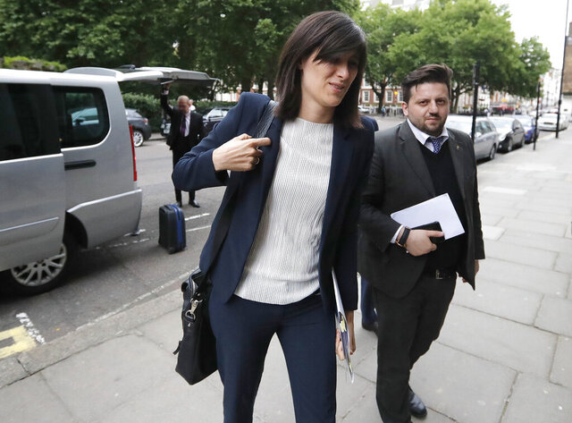 FILE - In this June 29, 2017 file photo, the Mayor of Turin, Italy, Chiara Appendino, arrives at the Italian embassy in London. Appendino and four others were convicted and sentenced to a year and six months in jail on Wednesday in connection with a stampede during a public viewing of a Champions League soccer game projected on a maxi-screen in one of the city's main piazzas. More than 1,600 people were injured, including two women who later died as a result. (AP Photo/Frank Augstein)