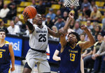 Colorado guard McKinley Wright IV, left, goes up for a basket as UC Irvine forward Austin Johnson defends in the second half of an NCAA college basketball game Monday, Nov. 18, 2019, in Boulder, Colo. (AP Photo/David Zalubowski)