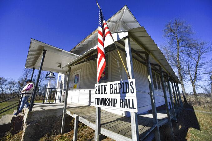 A voter leaves the Sauk Rapids Township Hall after casting a ballot Tuesday, Nov. 3, 2020, north of Sauk Rapids, Minn. (Dave Schwarz/St. Cloud Times via AP)