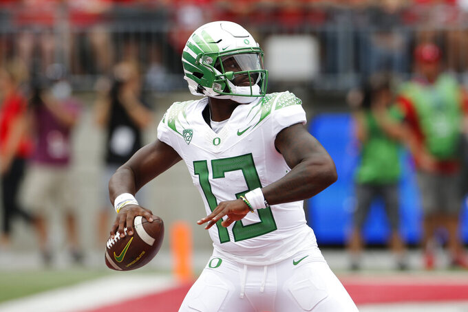 Oregon quarterback Anthony Brown drops back to pass against Ohio State during the first half of an NCAA college football game Saturday, Sept. 11, 2021, in Columbus, Ohio. (AP Photo/Jay LaPrete)