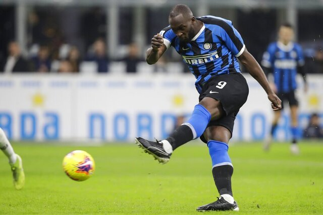 Inter Milan's Romelu Lukaku fires a shot during a Serie A soccer match between Inter Milan and Genoa, at the San Siro stadium in Milan, Italy, Saturday, Dec. 21, 2019. (AP Photo/Luca Bruno)