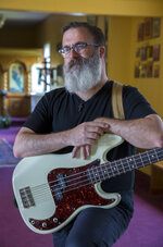 In this May 9, 2019 photo, Orthodox priest Christopher Foley poses for a photo in High Point, N.C. Foley was part of a '90s alt-rock band, Luxury, that is the subject of a new documentary film that has been shown at various film festivals and is now about to tour small cinemas starting in June. (H. Scott Hoffmann/News & Record via AP)