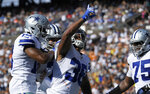 Dallas Cowboys running back Tony Pollard, center, celebrates his touchdown with teammates during the first half of a preseason NFL football game against the Los Angeles Rams on Saturday, Aug. 17, 2019, in Honolulu. (AP Photo/Mark J. Terrill)