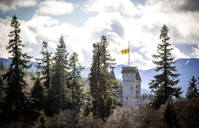 The Lion rampant flies at half mast at Balmoral Castle following the announcement of the death of Britain's Prince Philip, in Aberdeenshire, Scotland, Friday, April 9, 2021. Prince Philip, the irascible and tough-minded husband of Queen Elizabeth II who spent more than seven decades supporting his wife in a role that both defined and constricted his life, has died, Buckingham Palace said Friday. He was 99. (Jane Barlow/PA via AP)